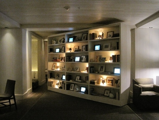 Turning bookshelf reveals a hidden room